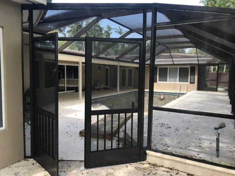 Screen enclosure patio with open door